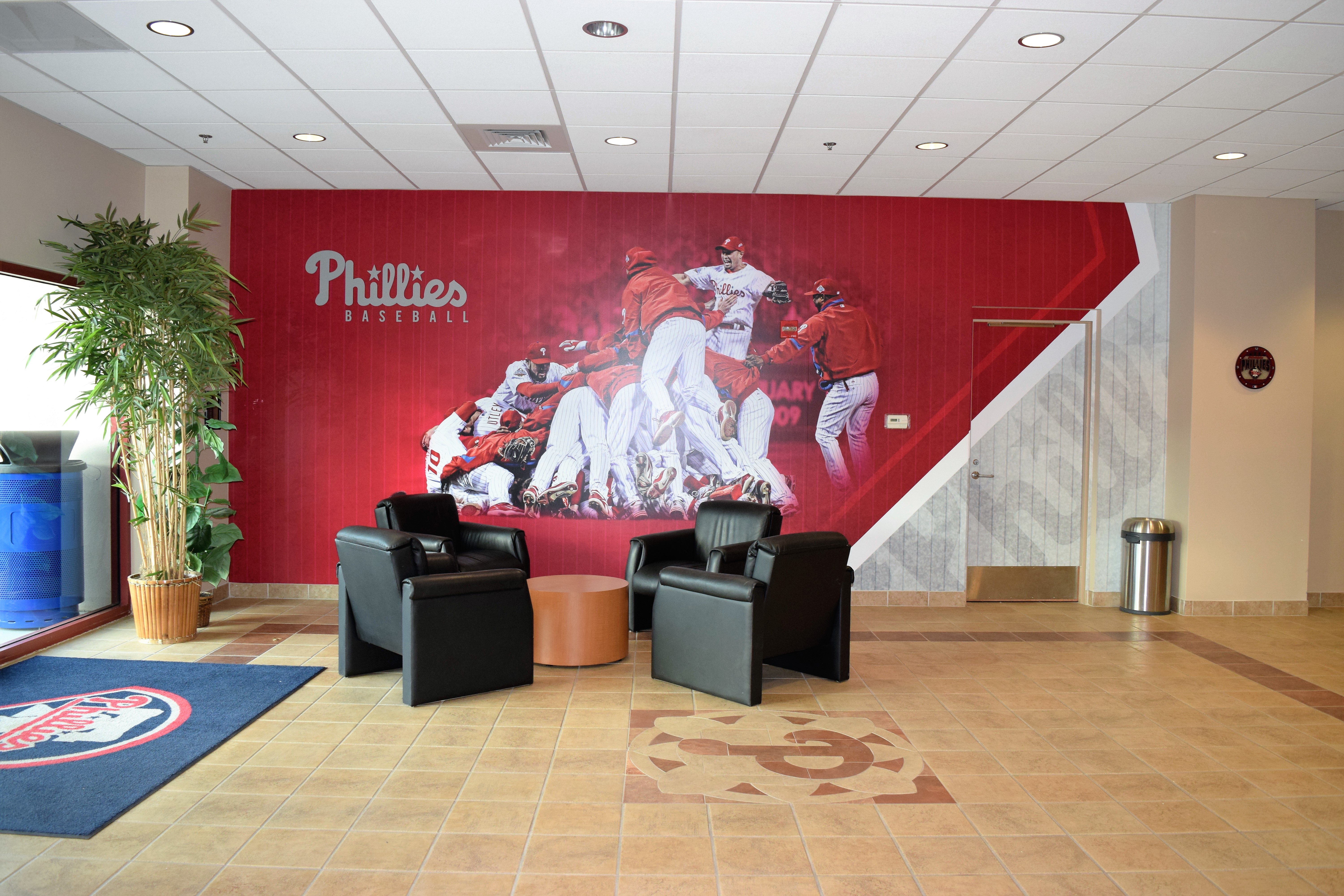 Sports facility wall mural designs by oai visual branding lobby with brushed aluminum display championship wall amipublicfo Choice Image