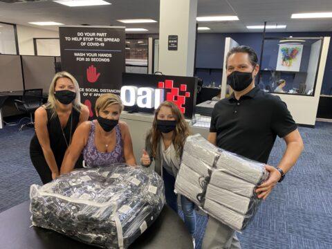 OAI Employees donating face masks